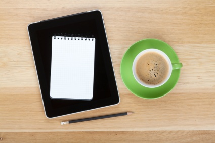 Touch screen tablet computer, notepad, pencil and cup of coffee