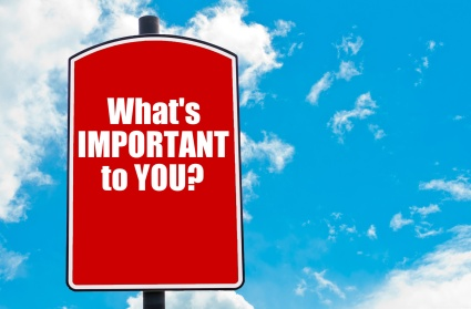 What Is Important To You?  motivational quote written on red road sign isolated over clear blue sky background. Concept  image with available copy space